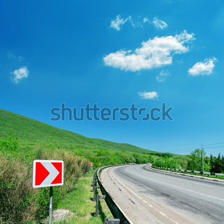 turn right sign, curved road and blue sky Stock photo © mycola