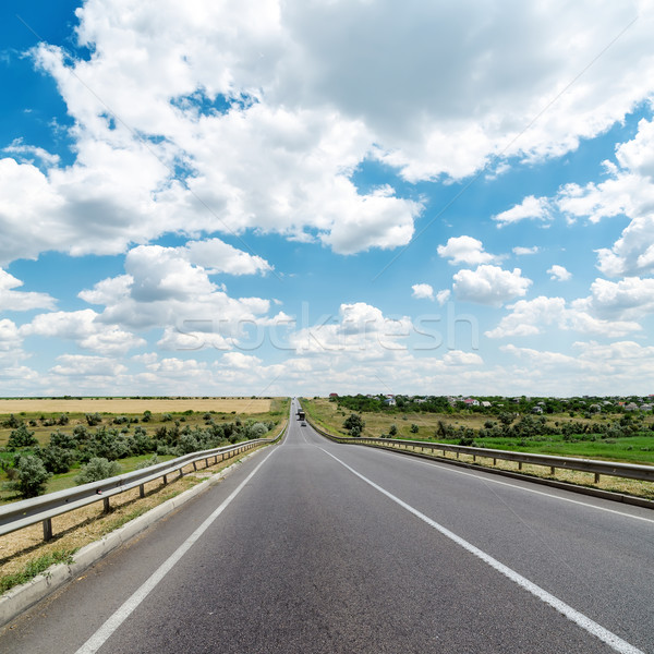 Asfalto estrada nublado horizonte primavera grama Foto stock © mycola