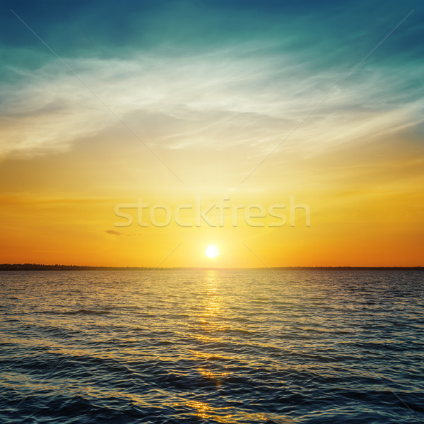 orange sunset and dark water Stock photo © mycola