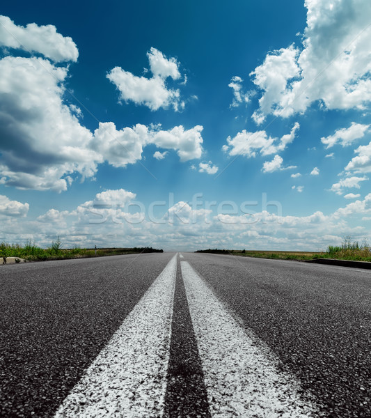 two white lines on black road and dramatic sky with clouds over  Stock photo © mycola