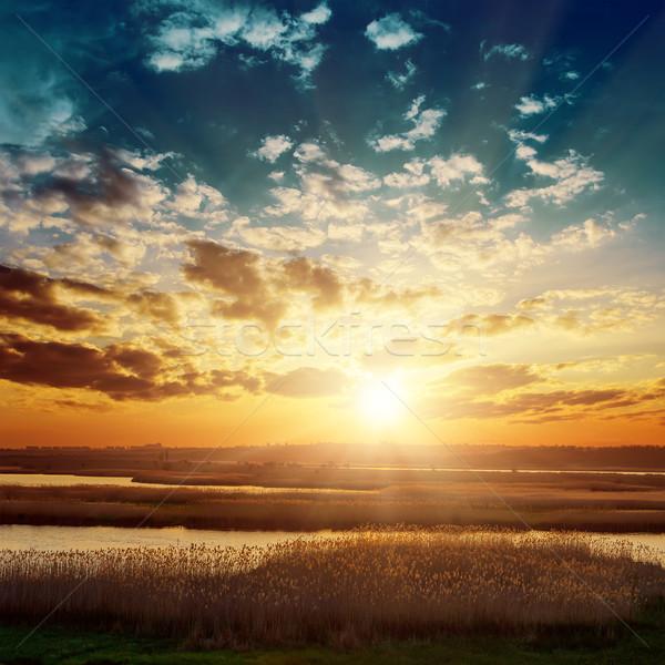 Fantastique coucher du soleil rivière paysage fond été Photo stock © mycola