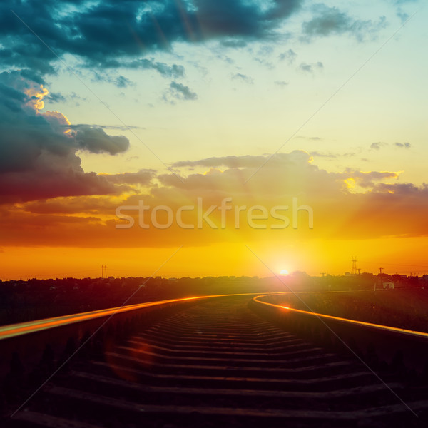 red dramatic sunset over railroad with reflections Stock photo © mycola