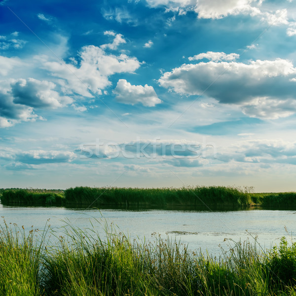 dramatic sky with clouds over river Stock photo © mycola