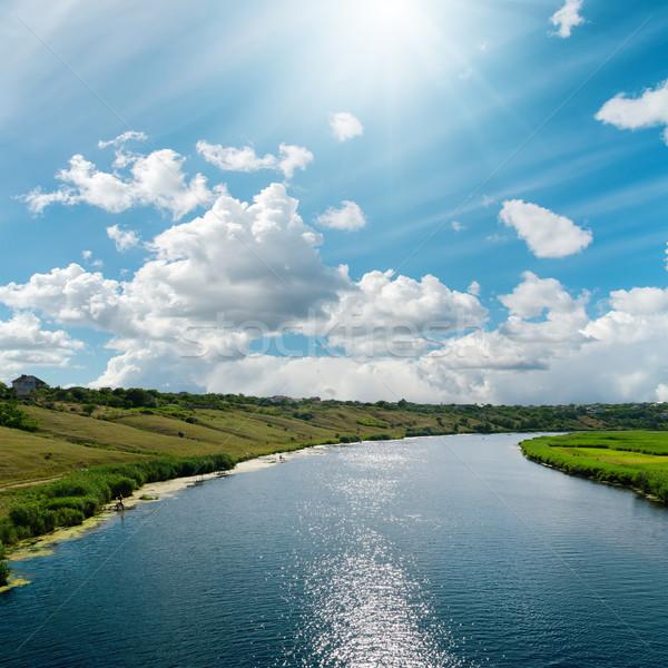 Rio reflexões azul nublado céu água Foto stock © mycola