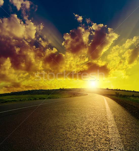 asphalt road to sunset Stock photo © mycola