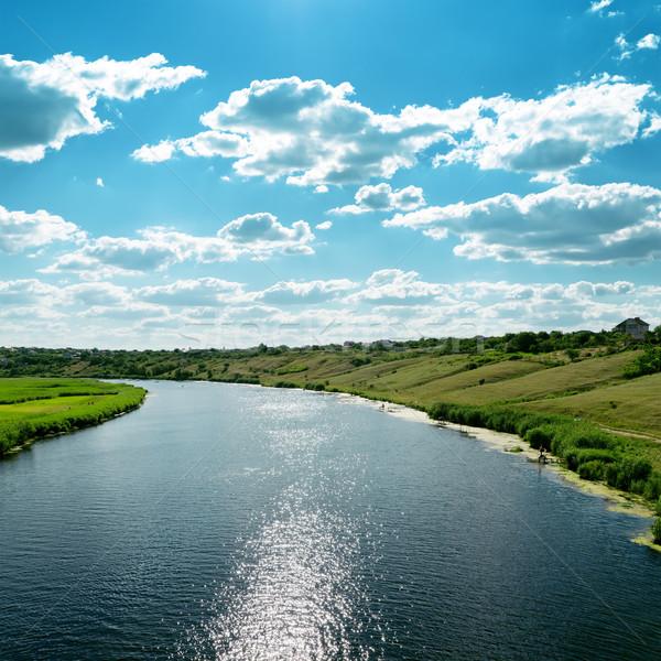 Nehir yansımalar mavi bulutlu gökyüzü çim Stok fotoğraf © mycola