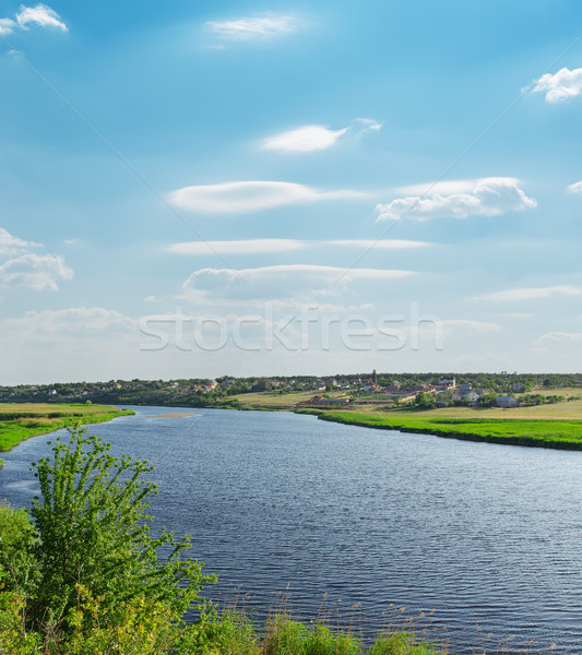 river with green riverside and light cloudy sky Stock photo © mycola