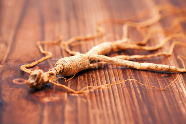 Stock photo: Dry ginseng on a wood background