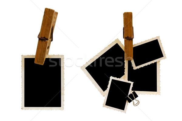 Hanging aged photo frames on white background Stock photo © myfh88