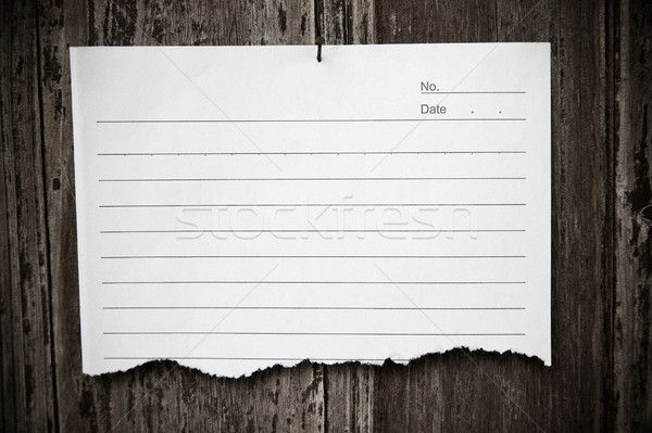Lined paper textured on wood background  Stock photo © myfh88