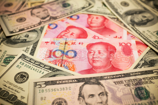 Chinese Yuan Note and U.S. dollar background  (Exchange rate concept) Stock photo © myfh88