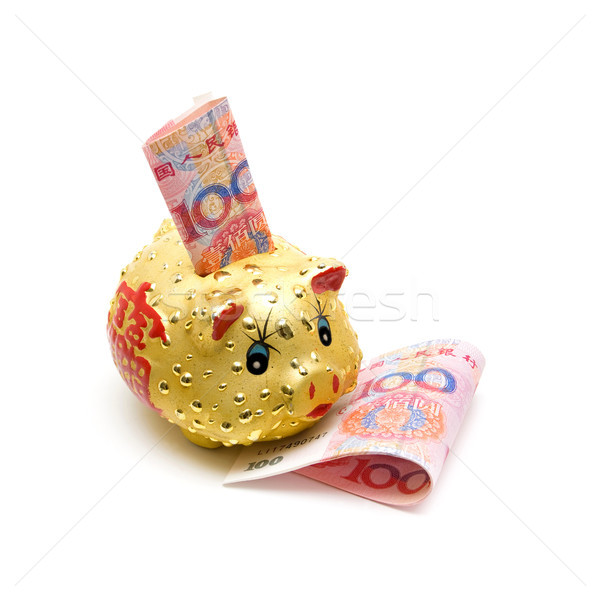Piggy bank and Chinese yuan note isolated on white background Stock photo © myfh88