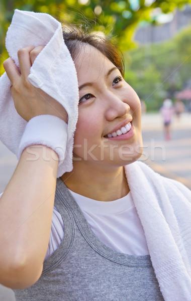 Asia mujer sudar toalla sonrisa Foto stock © myimagine