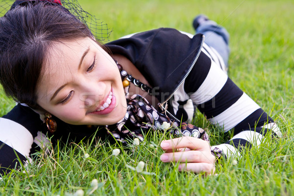 Asian woman relaxed on the grass Stock photo © myimagine
