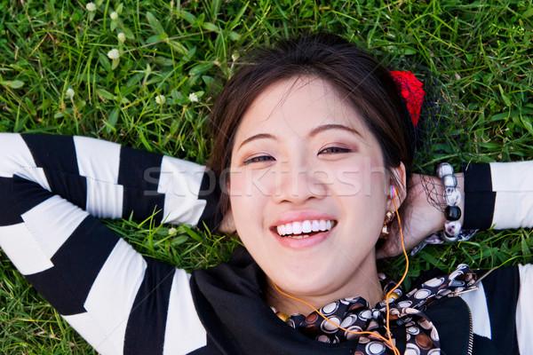 Asya kadın çim park mutlu gözler Stok fotoğraf © myimagine