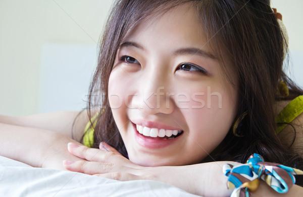 Asya gülümseyen yatak genç uyku gülmek Stok fotoğraf © myimagine