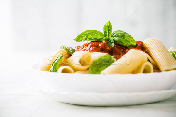 Pasta with tomato sauce Stock photo © mythja