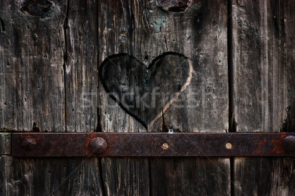 Heart carved in wood Stock photo © mythja