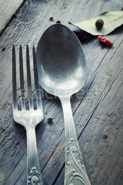 Fork and knife in rustic setting Stock photo © mythja