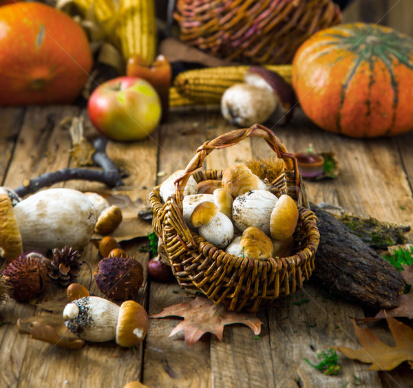 Autumn fruit on wood. Mushrooms in basket Stock photo © mythja