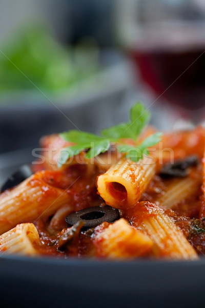 Penne with olives Stock photo © mythja