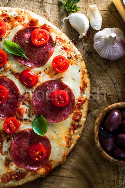 Fresh pizza on wood Stock photo © mythja
