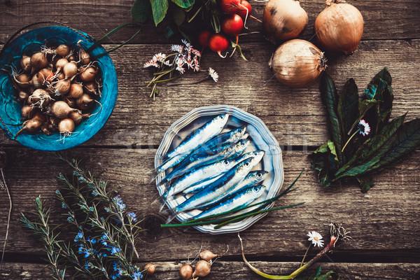 Fresh sardines on wood Stock photo © mythja