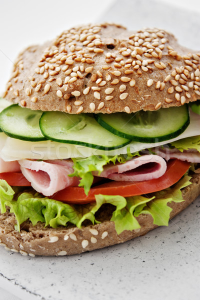Delicious ham, cheese and salami sandwich Stock photo © mythja