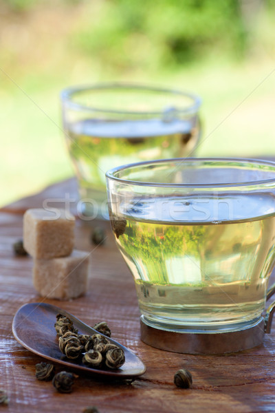 Green tea infuser with sugar cubes Stock photo © mythja