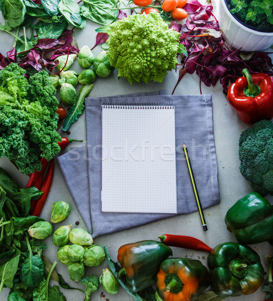 Notebook with vegetables  Stock photo © mythja