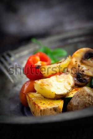 Roasted vegetables on wood Stock photo © mythja