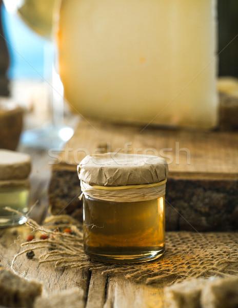 Honey on wood Stock photo © mythja