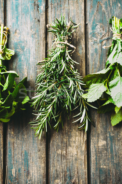 Fresh herbs on table Stock photo © mythja