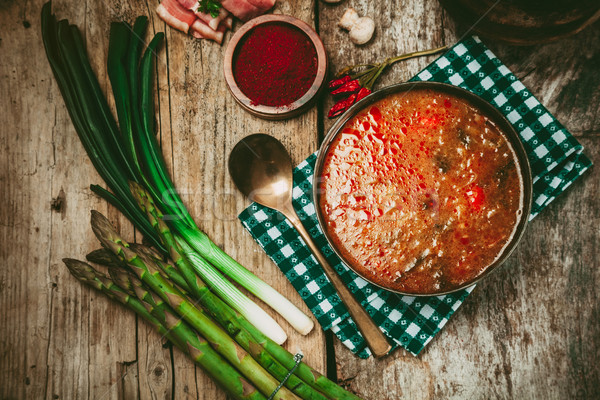 Vegetable stew. Delicious soup with vegetables and spices on wood. Stock photo © mythja