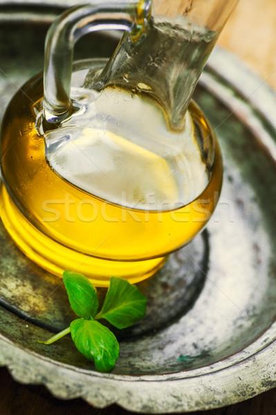 Olive oil and basil Stock photo © mythja
