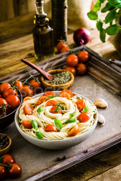 Pasta olijfolie italiaanse keuken knoflook basilicum tomaten Stockfoto © mythja