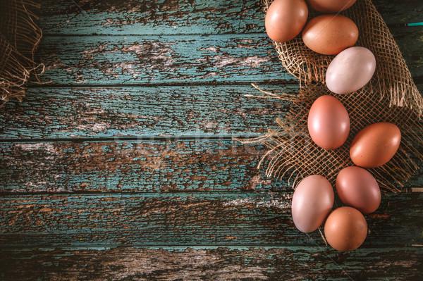 Eggs  on wood Stock photo © mythja