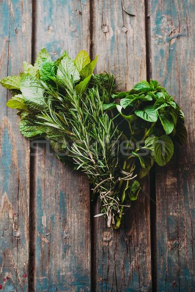 Fresh herbs on table Stock photo © mythja