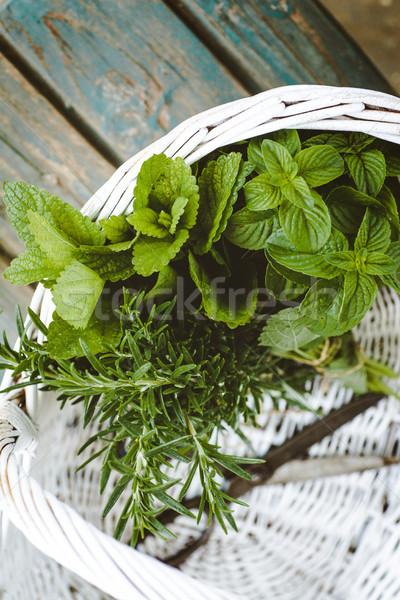 Fresh herbs in basket Stock photo © mythja