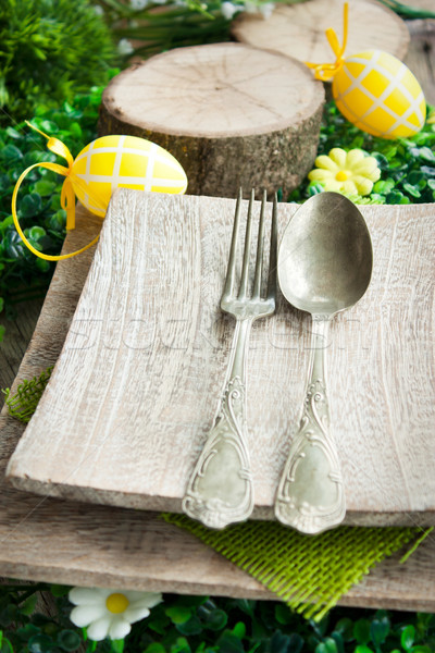 Restaurant menu series. Easter place setting. Fork and knife in rustic country table setting Stock photo © mythja