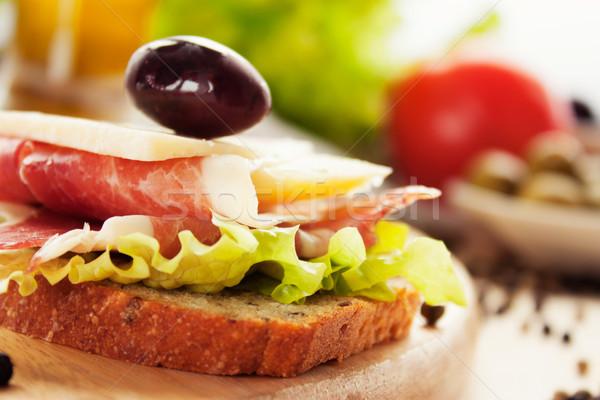 Prosciutto sajt szendvics olajbogyók saláta olaj Stock fotó © mythja