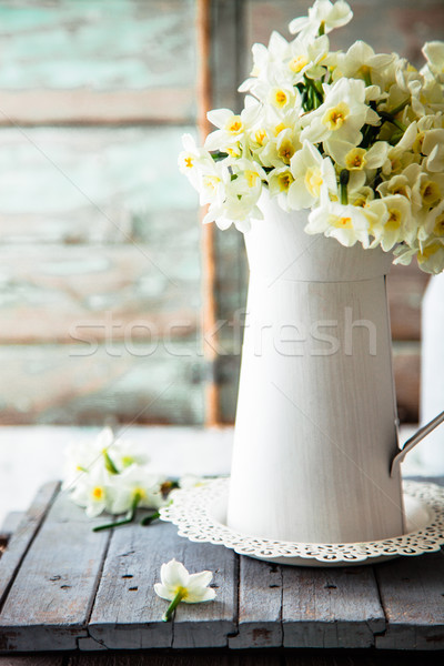 Stock photo: Spring flowers on wood