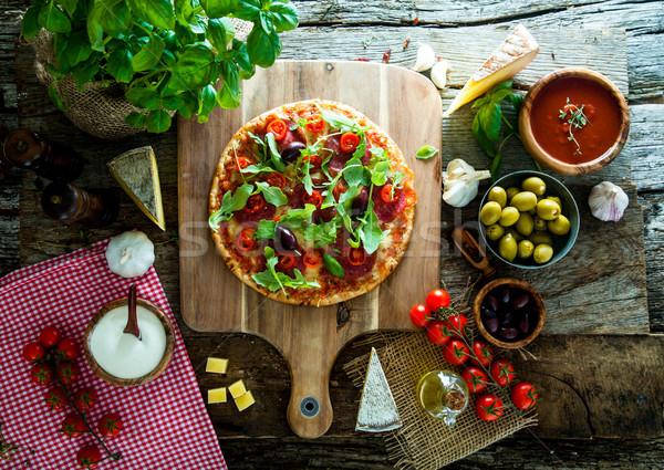 Fresh pizza on wood Stock photo © mythja