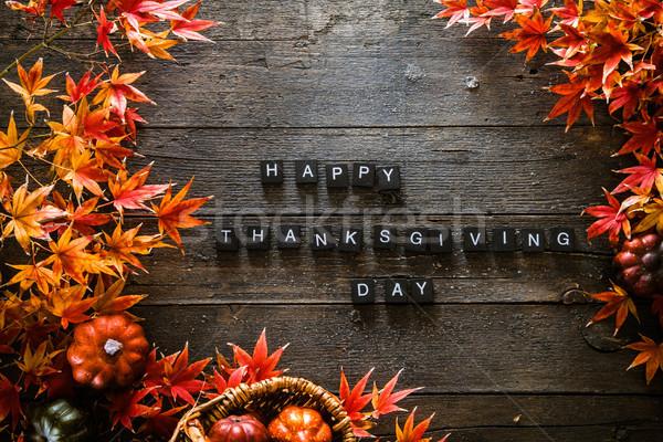 Thanksgiving dinner setting. Autumn leaves on wood Stock photo © mythja