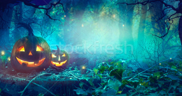 Halloween theme with pumpkins and dark forest.  Halloween design Stock photo © mythja
