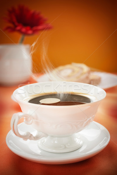 Coffee in white cup with cake in the back. Coffee background. Coffee concept with copyspace. Stock photo © mythja