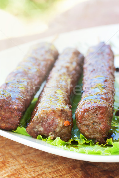 Bbq viande kebab barbecue servi laitue Photo stock © mythja