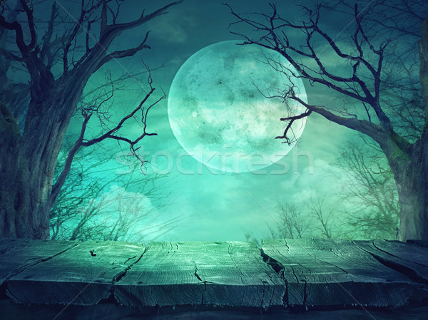 Stock photo: Spooky forest with full moon and wooden table