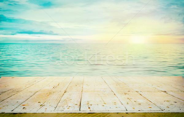 лет деревянный стол океана закат древесины доски Сток-фото © mythja