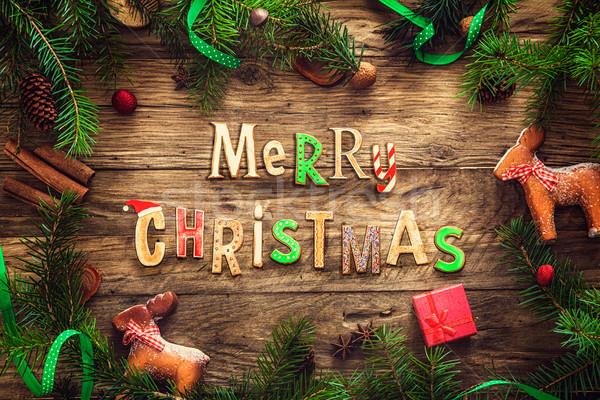 Gingerbread man Noel çelenk kart bo ahşap Stok fotoğraf © mythja